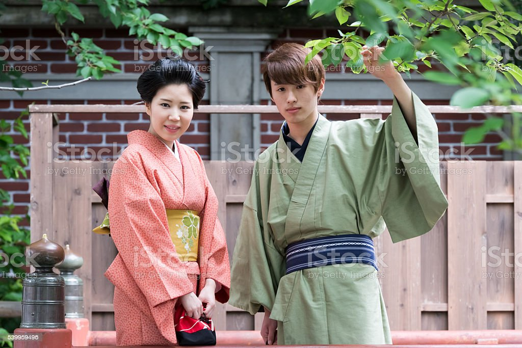 Young Japanese couple in Yukata on a bridge stock photo