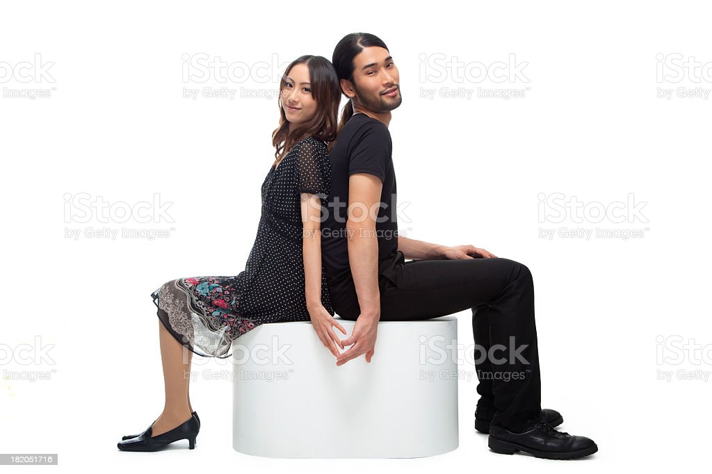 Young Japanese Couple Sitting, Touching Hands royalty-free stock photo