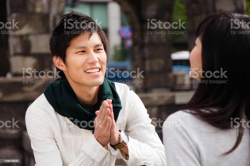 Young Japanese Man Asking for a Date stock photo