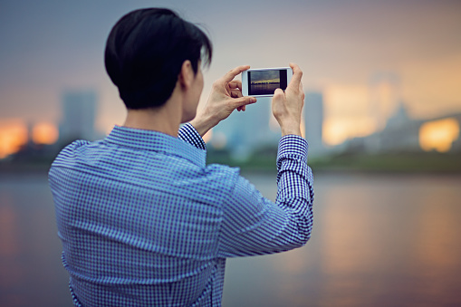 Young Japanese man is  taking photo