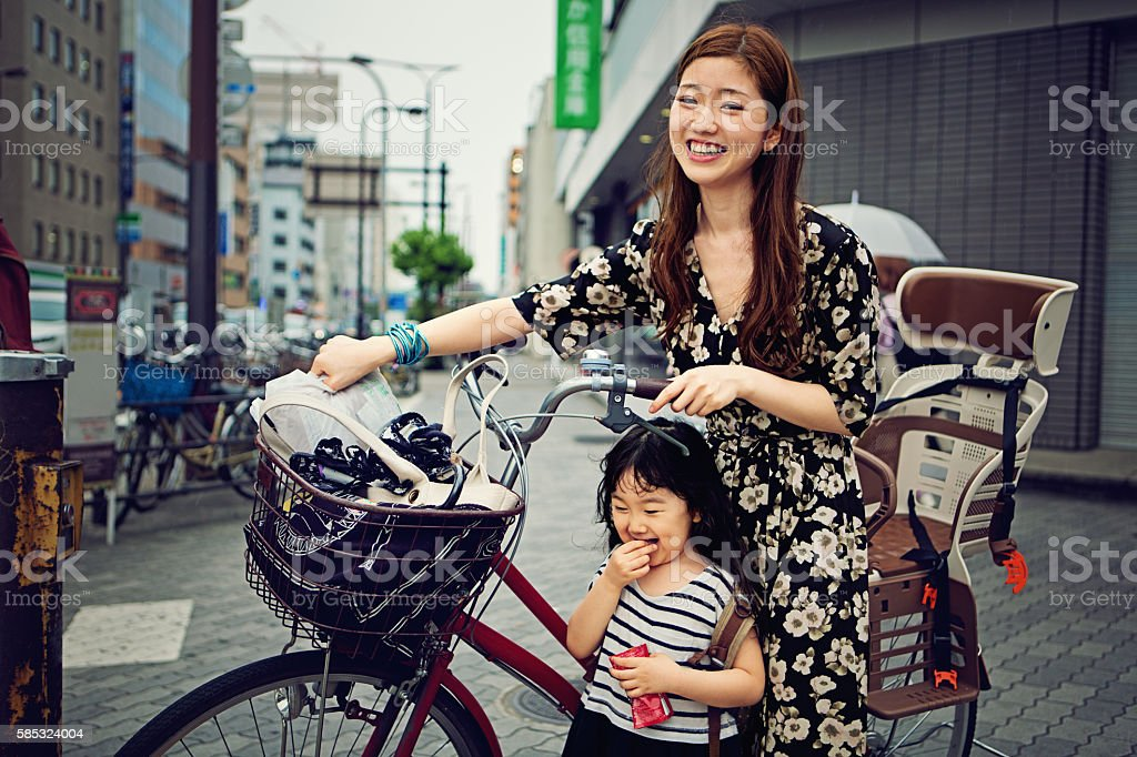 Young Japanese mother and her daughter stock photo