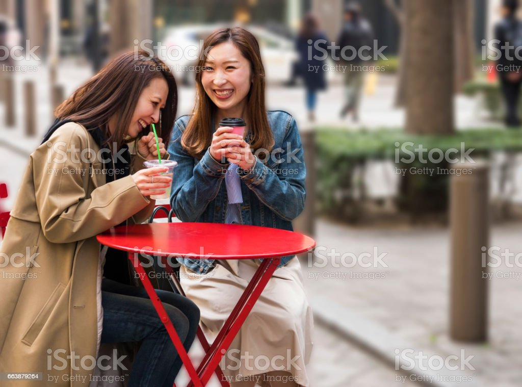 Young Japanese two women talking and having a tea in Tokyo stock photo
