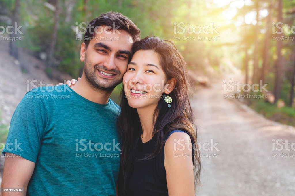 Young Japanese Woman and Indian Man Couple stock photo
