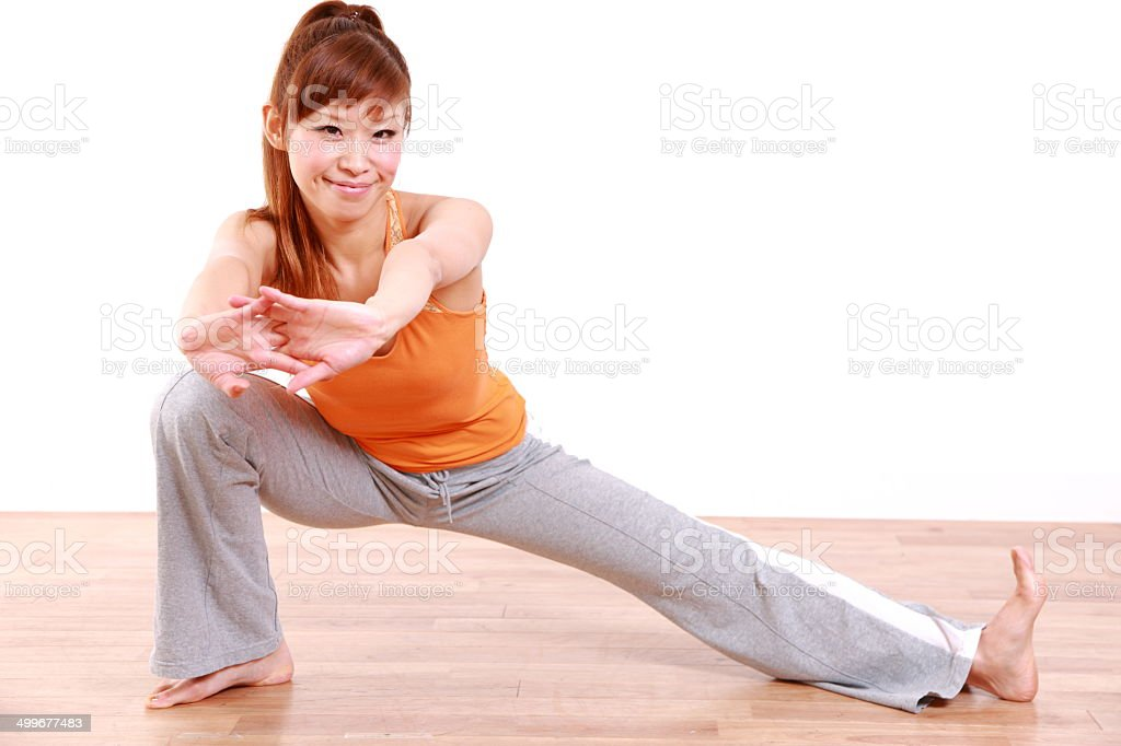 young Japanese woman doing stretch stock photo