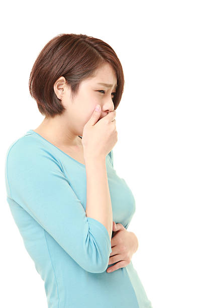 young Japanese woman feels like vomiting stock photo