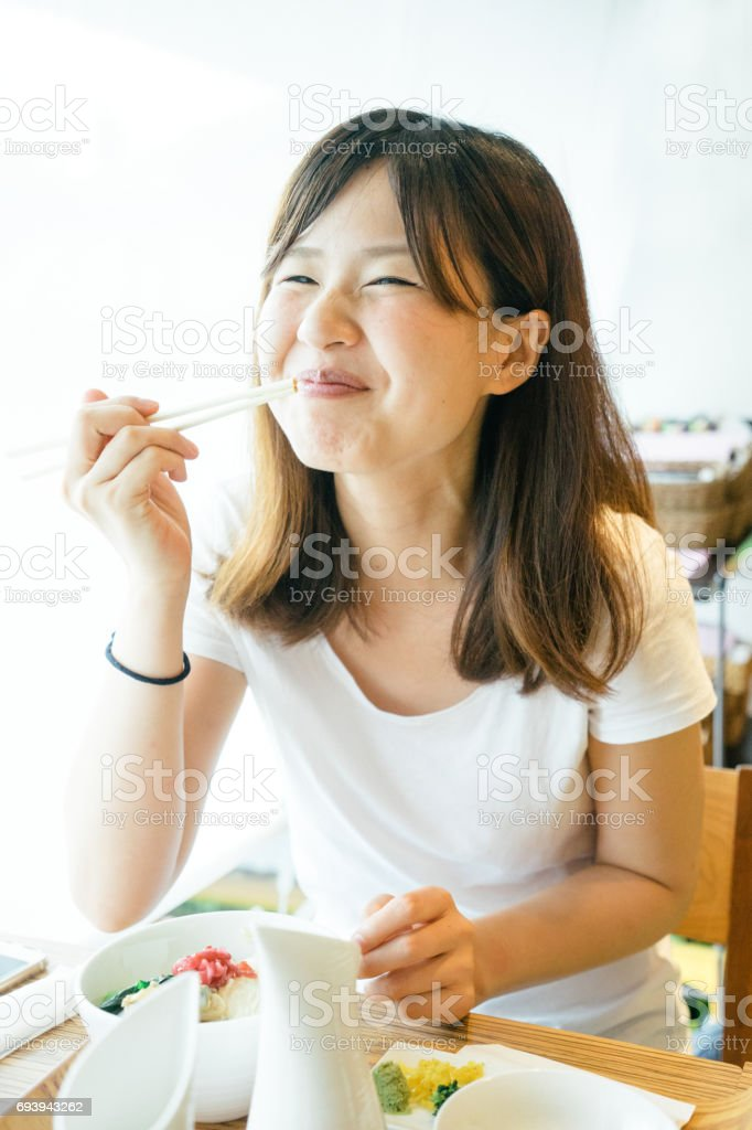 Young Japanese woman having lunch stock photo