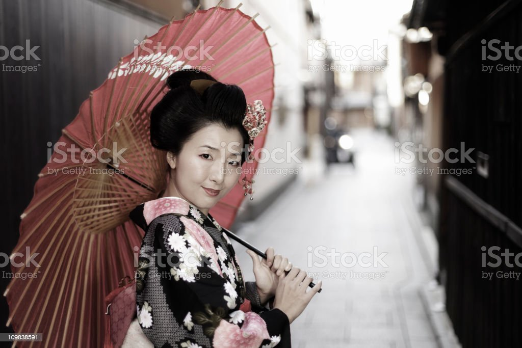 Young Japanese woman in a kimono with a parasol stock photo