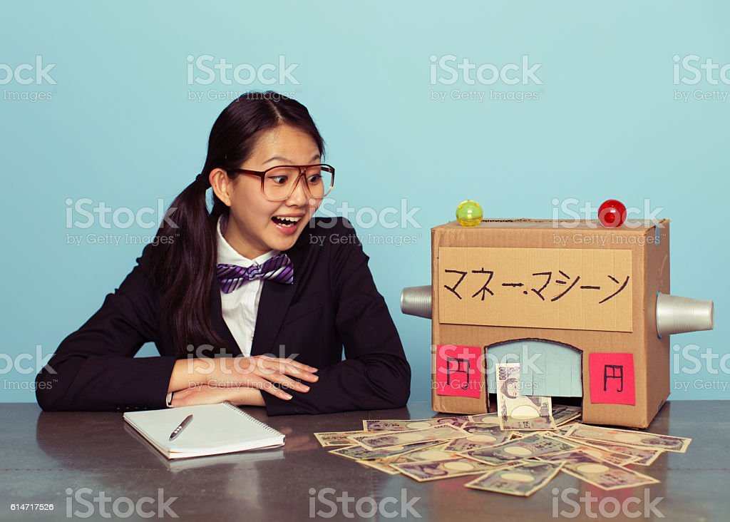 Young Japanese Woman in Business Suit makes Money stock photo