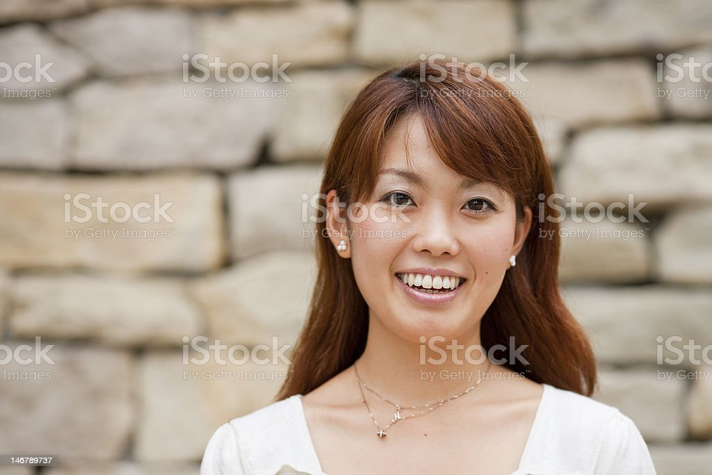 Young Japanese woman laughing royalty-free stock photo