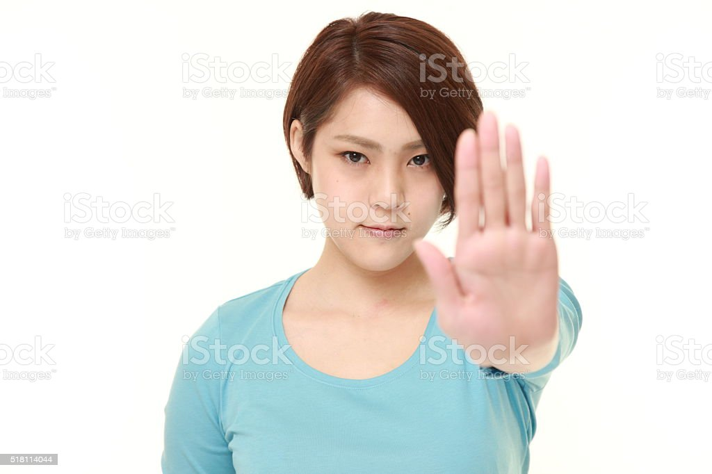 young Japanese woman making stop gesture stock photo
