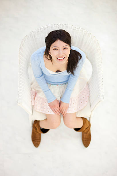 Young Japanese woman smiles and looks up stock photo