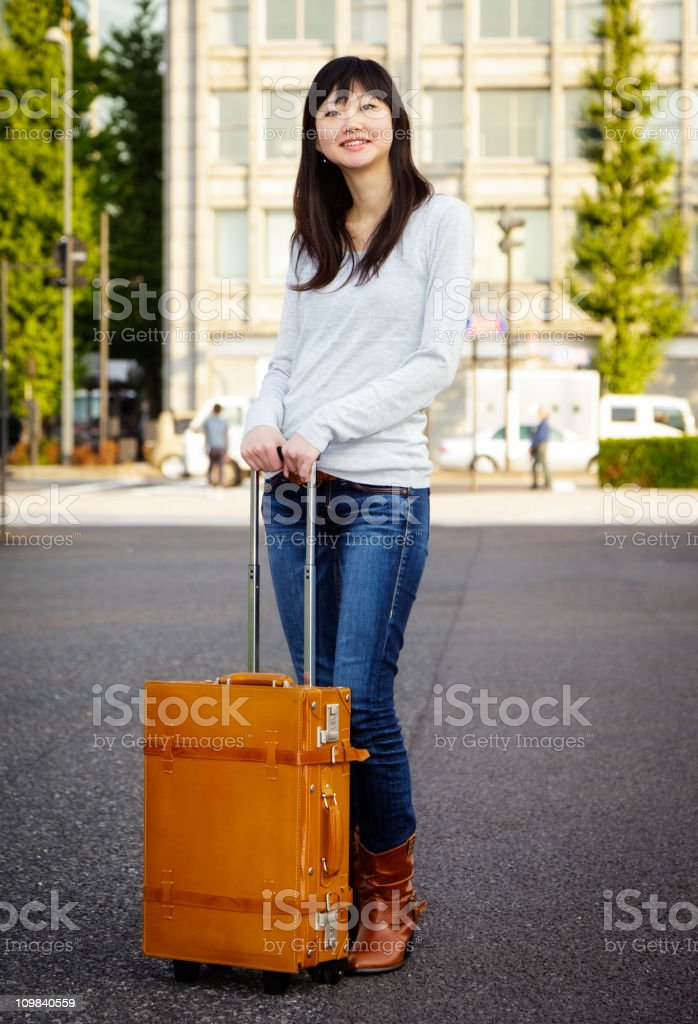 Young Japanese Woman with Suitcase stock photo