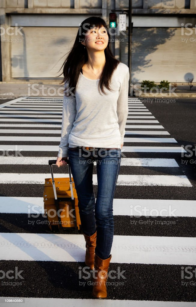 Young Japanese Woman with Suitcase royalty-free stock photo