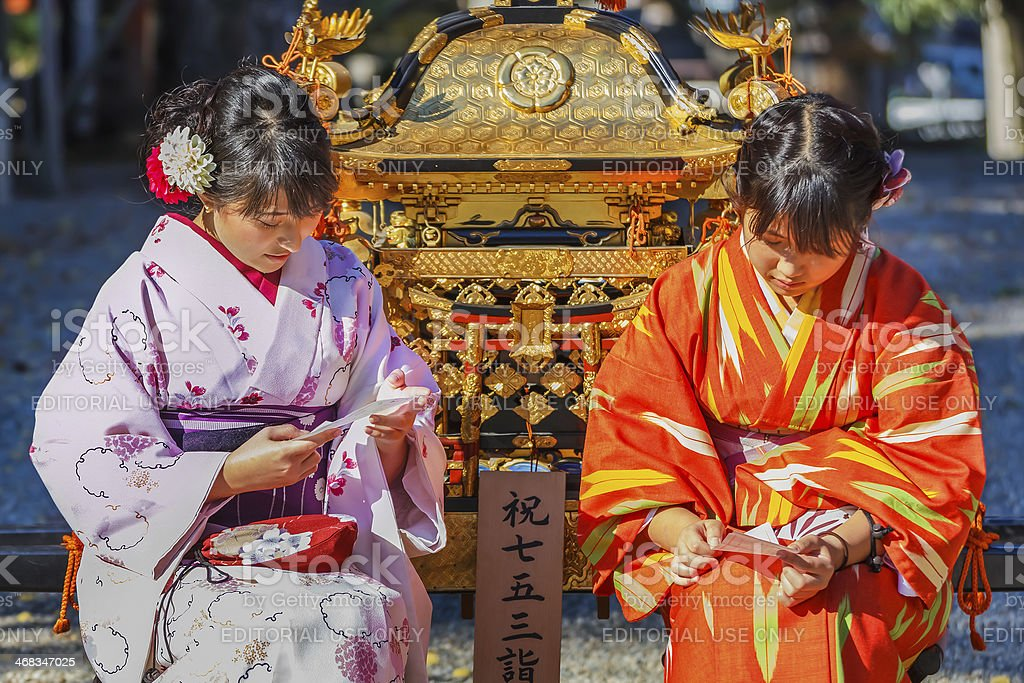 Young Japanese women at Yasaka-jinja in Kyoto royalty-free stock photo