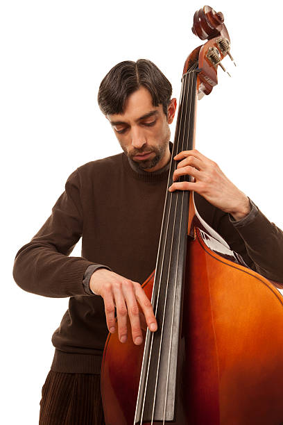 Young jazz musician playing bass (doublebass) isolated on white stock photo
