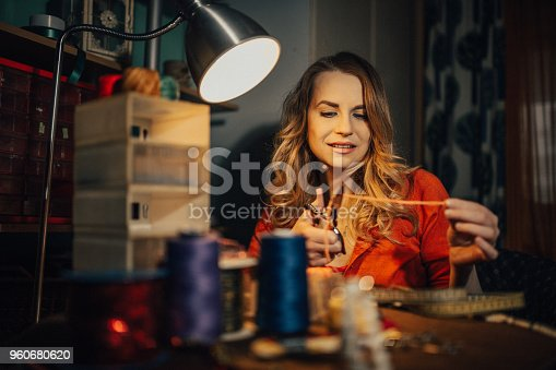 istock Young jeweler making jewelry in the shop 960680620