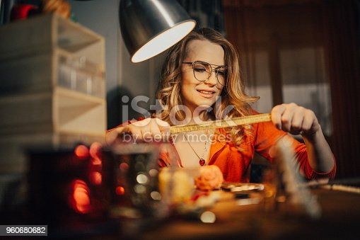 512345816istockphoto Young jeweler making jewelry in the shop 960680682