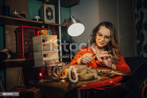 512345816istockphoto Young jeweler making jewelry in the shop 960680722