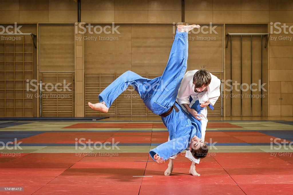 young judokas fighting stock photo