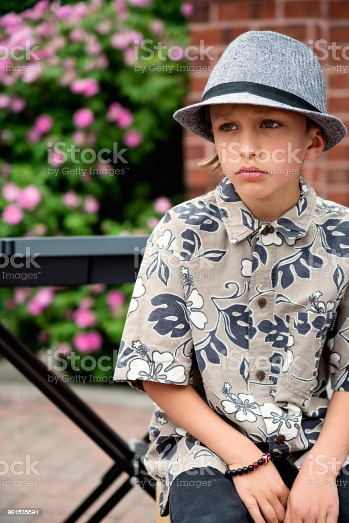 Young keyboard player waiting before show in family driveway. stock photo