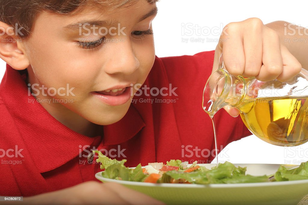 Young Kid Enjoying A Healthy Salad stock photo