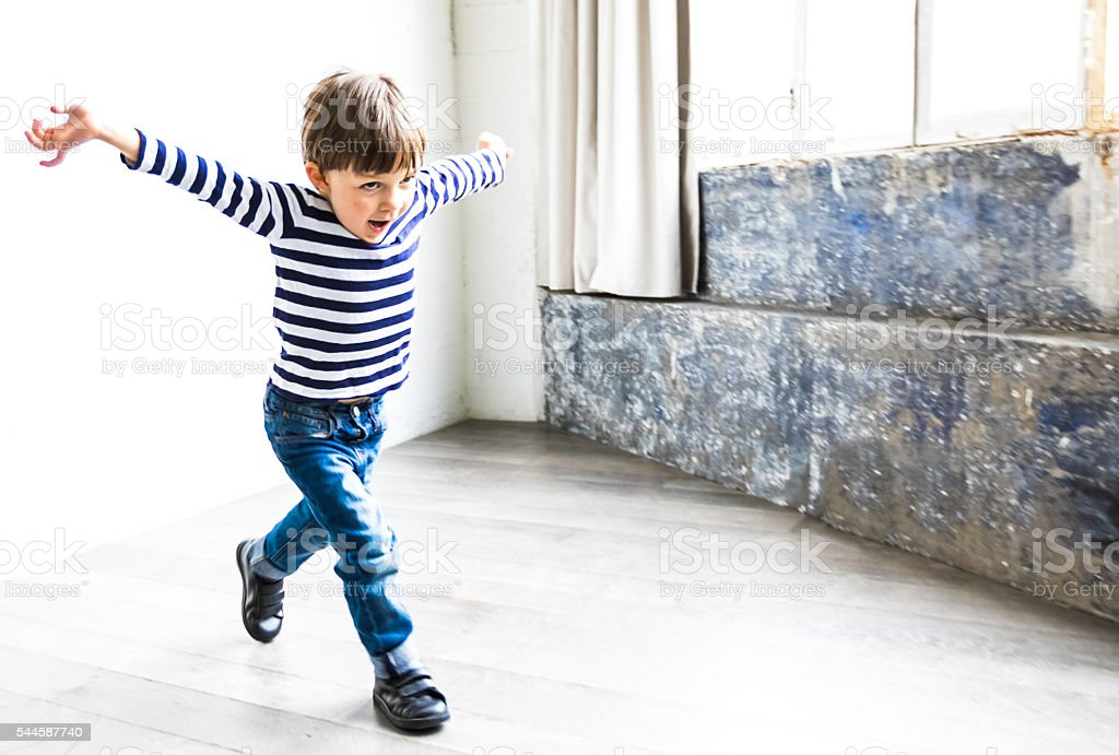 Young kid playing at home stock photo