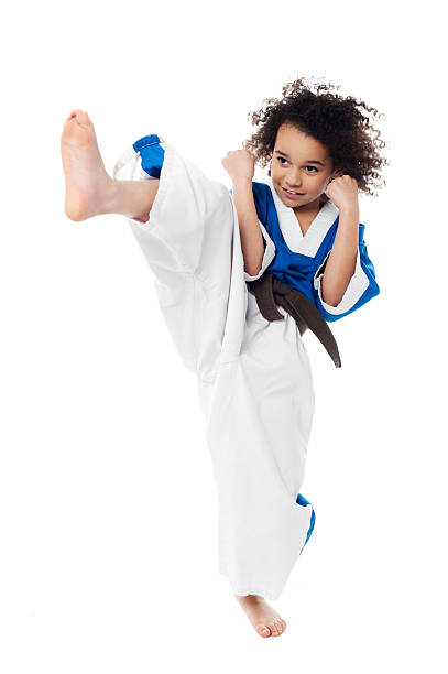 Young kid practicing karate stock photo