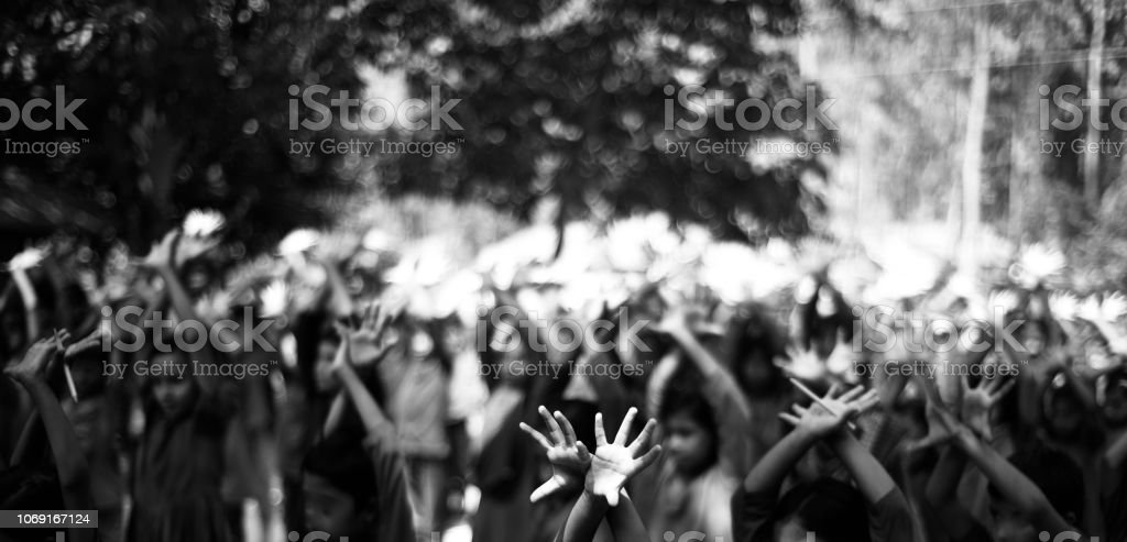 Young kids doing exercise by hands in an assembly stock photo