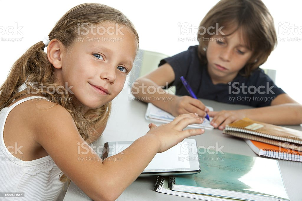 Young kids doing schoolwork together at desk. royalty-free stock photo