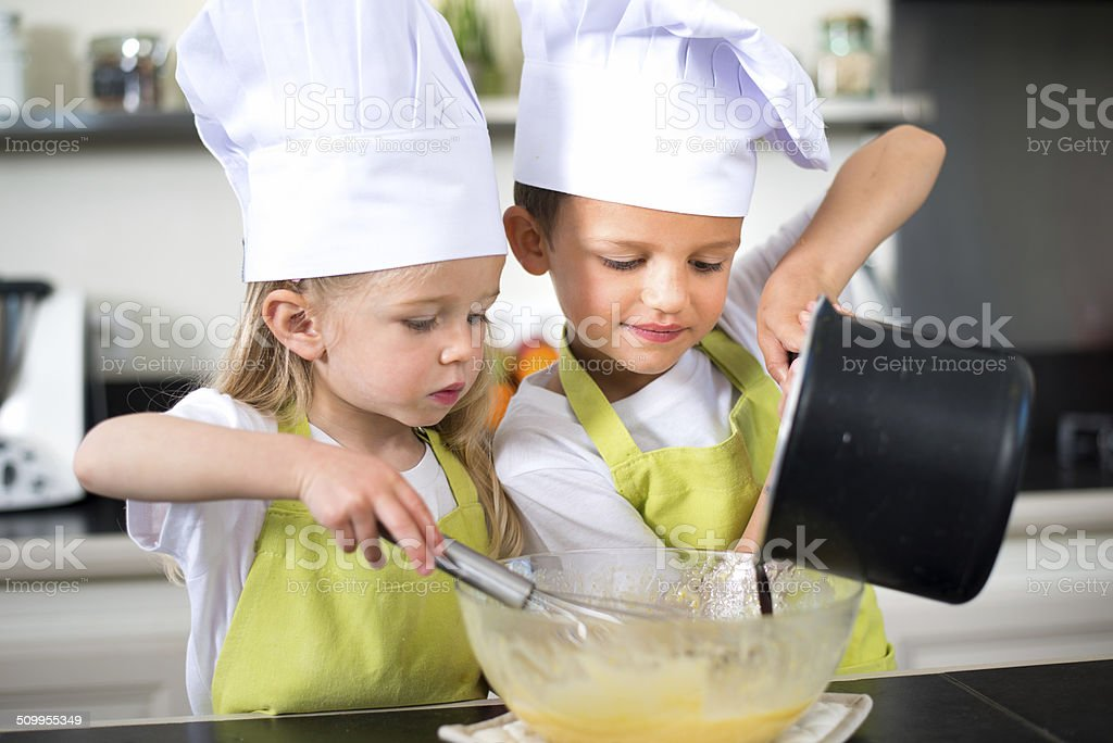 young kids happy childrens family preparing funny cake kitchen home stock photo