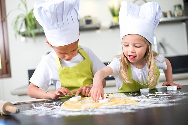 young kids happy childrens family preparing funny cake kitchen home - een taart bakken stockfoto's en -beelden