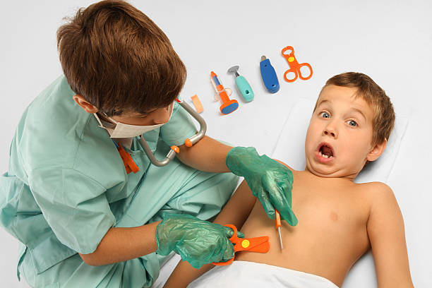 Young kids playing doctor. stock photo