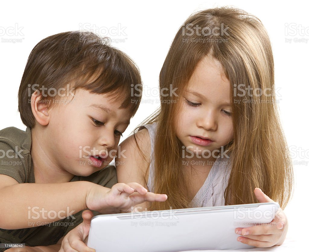 Young kids playing with digital tablet stock photo