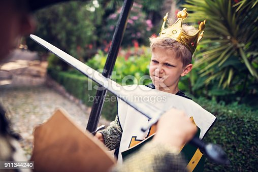 istock Young king practicing swordplay in the castle gardens 911344240