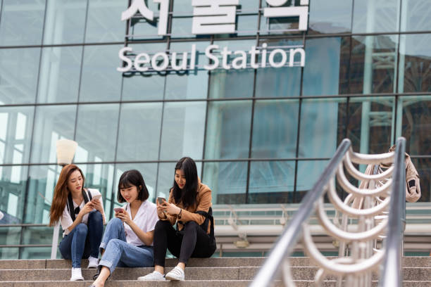 Young Korean tourists just arrived in the Seoul stock photo
