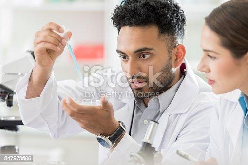 istock Young lab interns experiment using petri dish 847973506