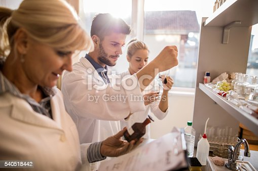 istock Young laboratory technician examining test tube in a laboratory. 540518442