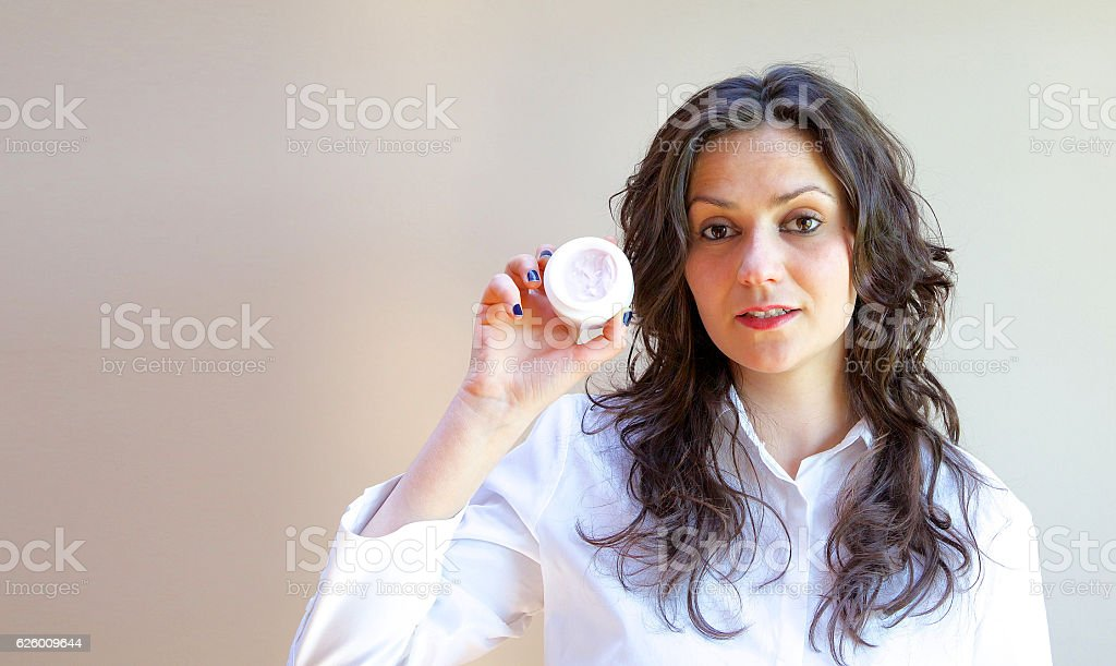 Young lady and a cream stock photo