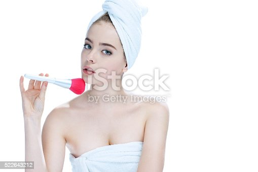 istock Young lady applying blusher 522643212