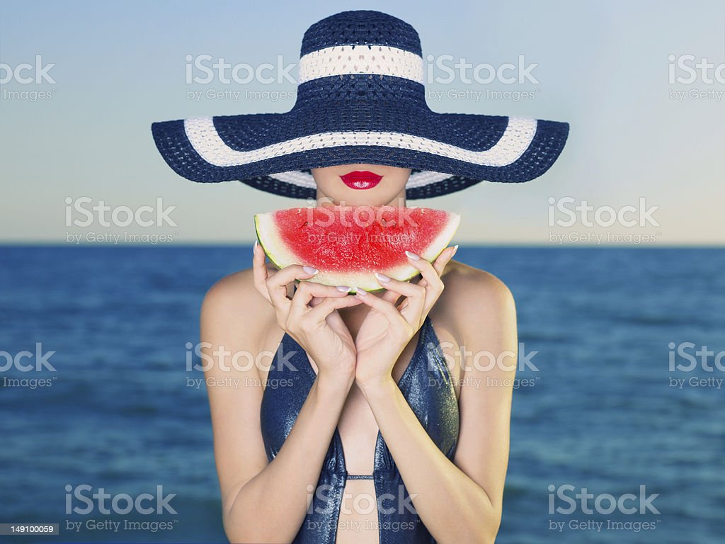 Young lady at sea with watermelon royalty-free stock photo