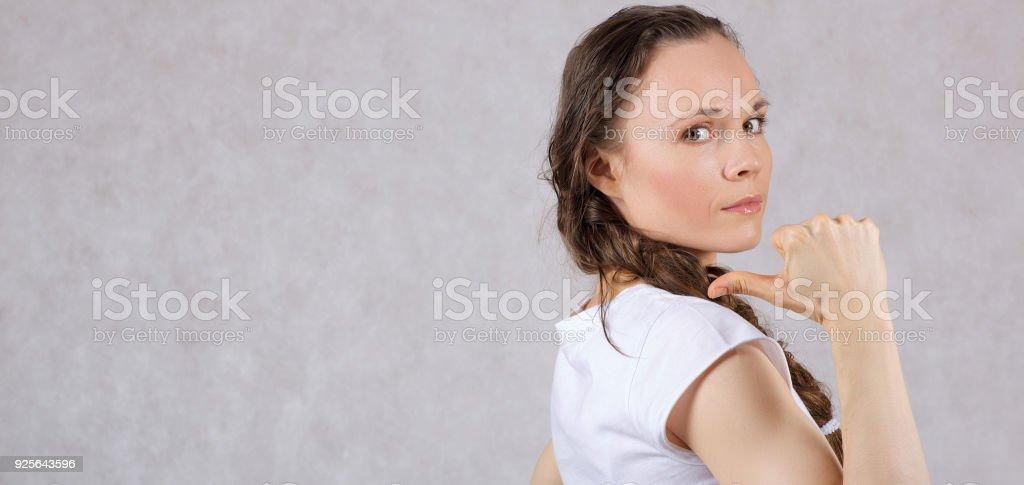 Young Lady Between 30 And 40 Years Old With Long Hair Shows Vacant