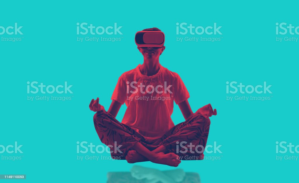 Young lady doing yoga and exercise with virtual reality glasses Young lady doing yoga and exercise with virtual reality glasses 30-34 Years Stock Photo