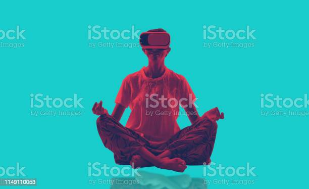 Young Lady Doing Yoga And Exercise With Virtual Reality Glasses Stock Photo - Download Image Now