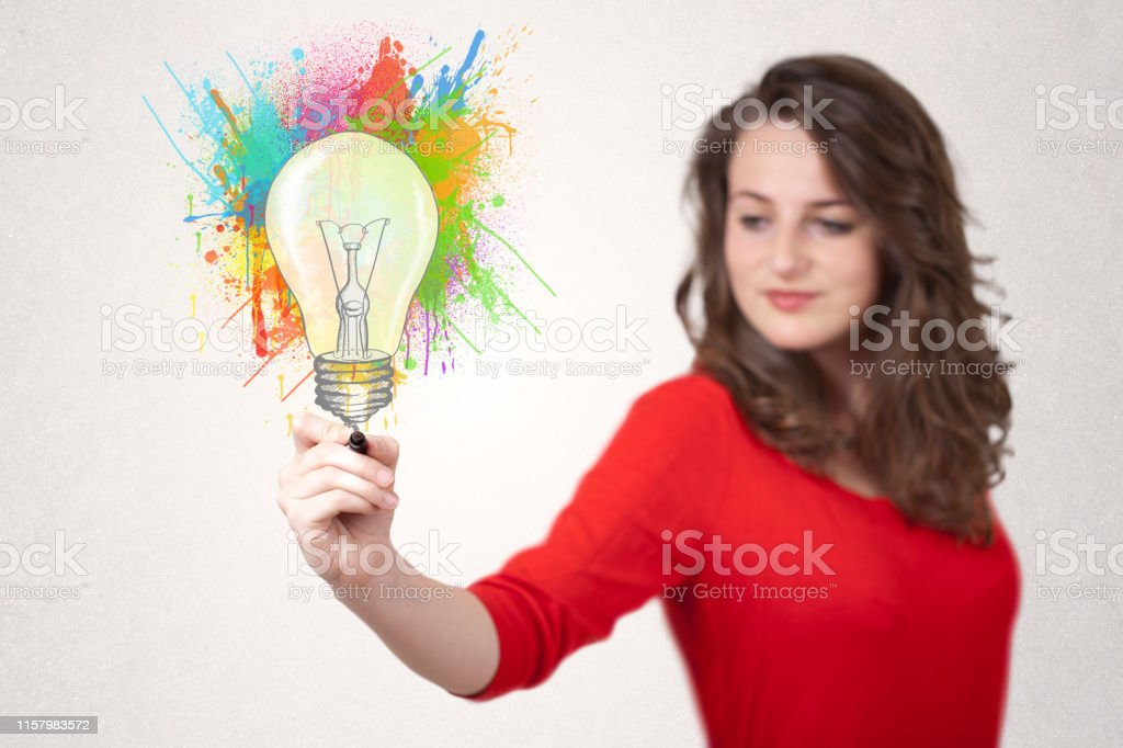 Young lady drawing a colorful light bulb with colorful splashes on...