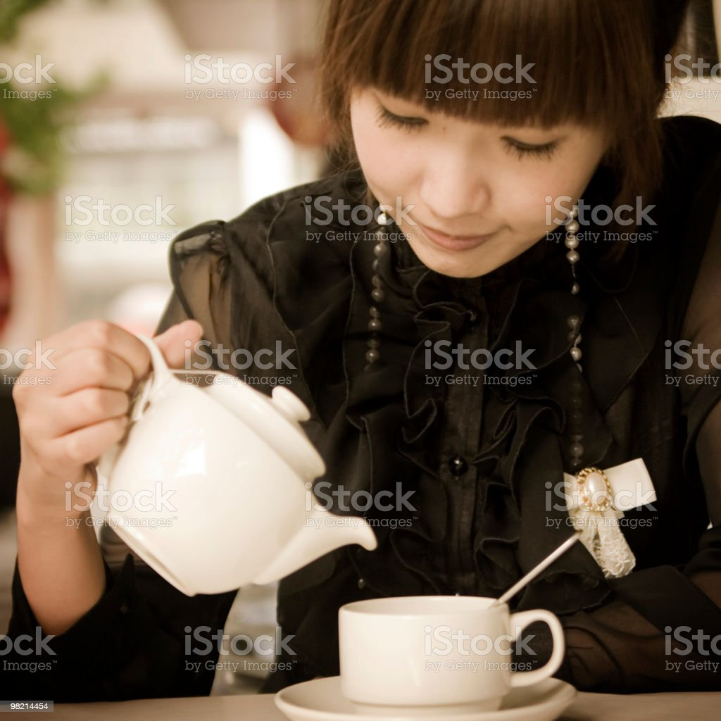 Young lady drinking tea royalty-free stock photo