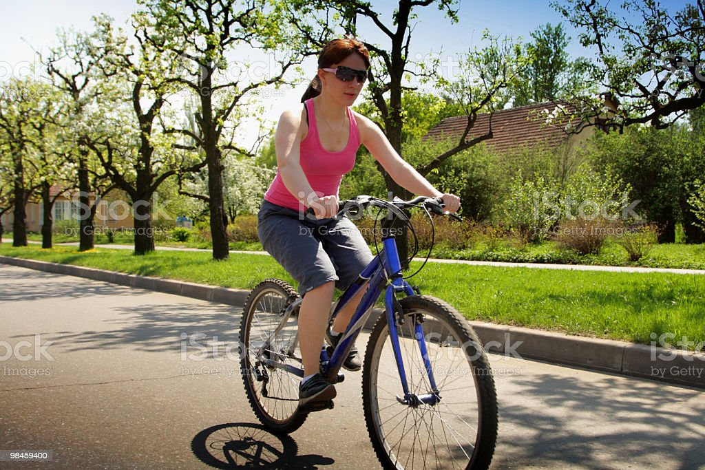 young lady driving bycicle royalty-free stock photo