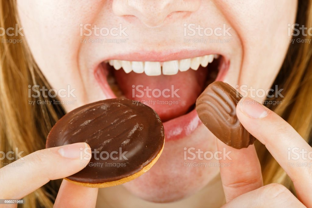 Young lady eating candy stock photo