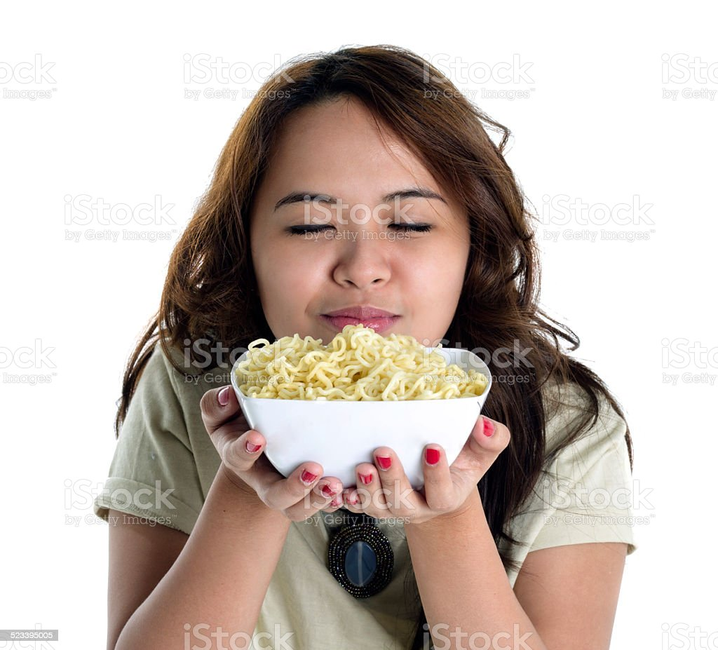 young lady holding a bowl of noodles stock photo