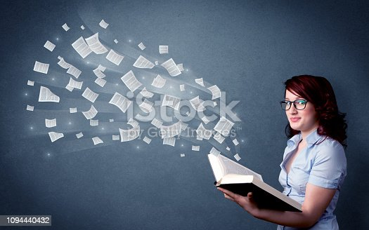 istock Young lady holding book 1094440432