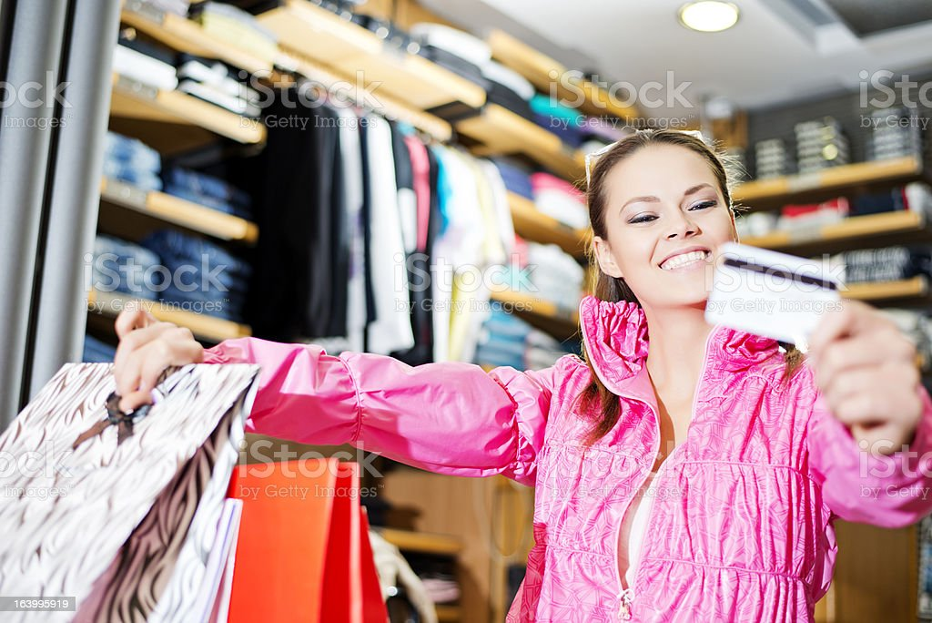Young lady holding credit card while shopping royalty-free stock photo